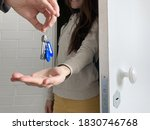 woman getting keys of new home | Shutterstock . vector #1830746768