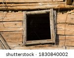 Wooden Window Of A Barn With A...