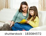 mother helps daughter with her... | Shutterstock . vector #183084572