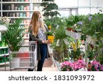 Woman Buying Flowers Shopping...