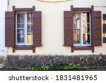 Two Windows With Wooden...
