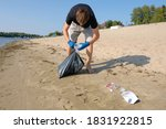 A Volunteer Collects Plastic...