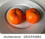 Two Fresh Orange Tangerines O...