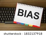 Small photo of The word bias is written on a white piece of paper that is on the keyboard. the concept of bias bias of personal opinion,. High quality photo