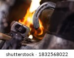Horseshoe With Tool On Anvil In ...