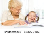 grandmother teaches to read a... | Shutterstock . vector #183272402