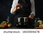 The Professional Chef In Black...