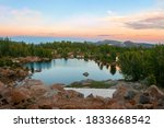 Sunset Over Alpine Lake And...