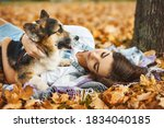 Young Female Owner Huging Pet...