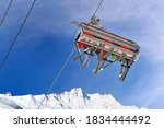 View On Chairlifts With Skiers...