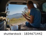 young man resting in nature... | Shutterstock . vector #1834671442