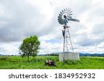 Farm Scene With Windmill And...