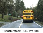 A School Bus Stops On A Rural...