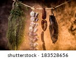 Ham, sausage and garlic in a homemade smokehouse - stock photo