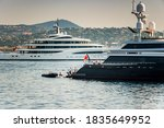Two Super Yachts Anchored In...