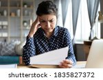 Indian Woman Sit At Desk Hold...