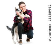 Stock photo happy women with her puppy husky in the studio isolated on white background 183589952