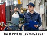 Inspector Checking A Gas Tank...