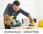 focus carpenter sawing wood... | Shutterstock . vector #183637406