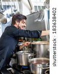 attractive smiling cook or chef ... | Shutterstock . vector #183638402