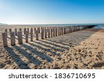 Row Of Weathered Wooden Poles...