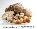 Mushrooms Mix On The White...
