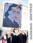 Small photo of Washington D.C./ USA - October 17th, 2020 - Count On Us Women's March 2020: Ruth Bader Ginsburg protester honoring her with a sign and outfit.