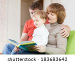 happy parents with child looks... | Shutterstock . vector #183683642