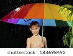 boy sheltering from rain... | Shutterstock . vector #183698492