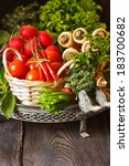 Fresh vegetables and herbs on an old plate. - stock photo
