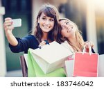 beautiful girls with shopping... | Shutterstock . vector #183746042