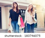 beautiful girls with shopping... | Shutterstock . vector #183746075
