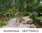 Wooden Bridge Over Pond In...