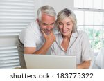 smiling mature couple using... | Shutterstock . vector #183775322
