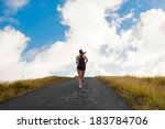 Young Lady Running On A Road U...