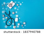 Small photo of Christmas, medicine greeting card. Christmas decorations, pills on a blue background. Medical concept. Copy space, flat lay.