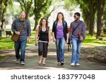 Stock photo full length of multiethnic university students walking on campus road 183797048