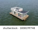 A Houseboat On A Lake In The...