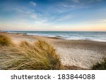The Beach And Sand Dunes At...
