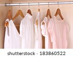 female clothes on hangers in... | Shutterstock . vector #183860522