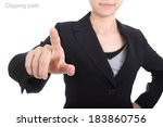 Businesswoman touching something include clipping path  - stock photo