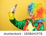 Clown Standing Over Yellow...