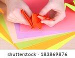 hands making origami crane ... | Shutterstock . vector #183869876