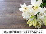 white lily flowers on wooden... | Shutterstock . vector #1839722422