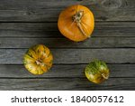 Three Pumpkins On A Background...