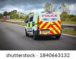 Police Car Siren Flashing Blue...