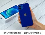 Small photo of iPhone 12 in blue after phone was purchased on launch day. Manhattan, New York, USA October 23, 2020.