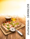 pizza on the wooden table | Shutterstock . vector #184086158