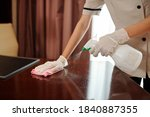 Maid Wearing Rubber Gloves Whe...