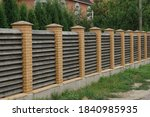 Long Brown Fence Wall Made Of...